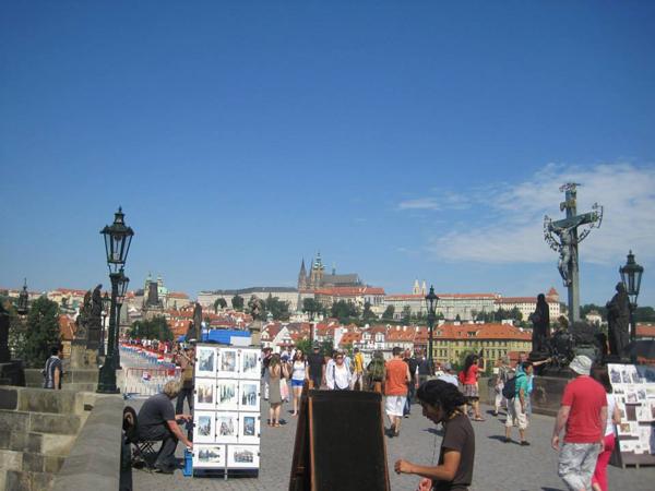 Prague artists by the bridge