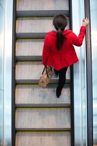woman escalator
