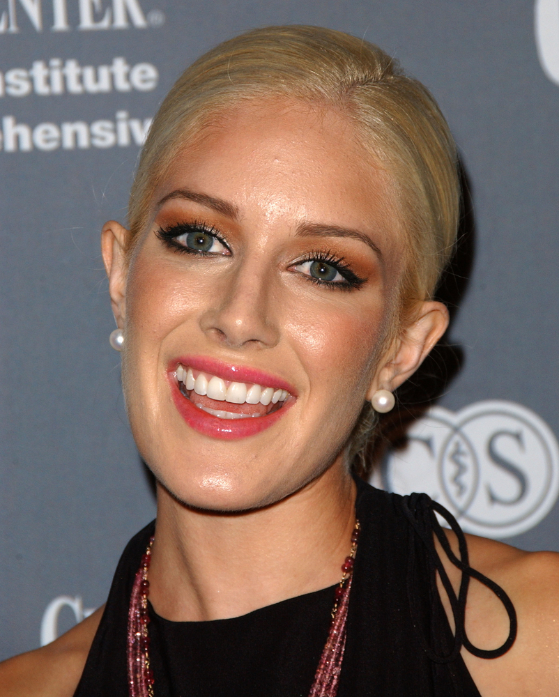 Plastic surgery enthusiast Heidi Montag includes a chin implant in the ten surgeries she has had since 2009