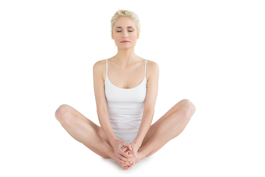 Full length of a toned young woman doing the butterfly stretch a