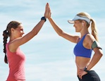 Two female runners high-fiving each other, 8 weeks to achieving your goals: It's Week Five and Alice Hart-Davis is taking steps towards her book project, by Healthista.com