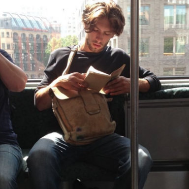 Hot dude reading on train, We love: Hot Dudes Reading, by Healthista.com