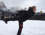 Rachel doing a yoga pose near ski lifts, Snowga - the perfect preparation and recovery lesson for skiing season, by Healthista.com