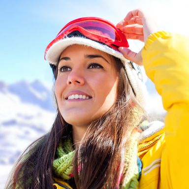 Woman in ski gear, should you wear sunscreen during winter, by Healthista.com