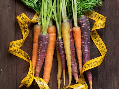 Fresh organic rainbow carrots and yellow measuring type
