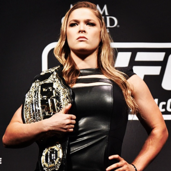 ronda rousey with championship belt, boxing and women by healthista.com