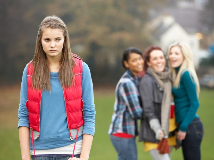 Upset Teenage Girl With Friends Gossiping In Background, Why 2015 is the year to love your body, by Healthista.com