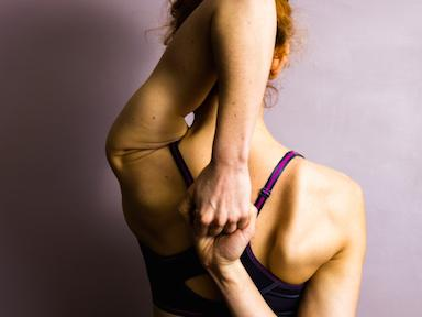 woman-holding-fists-does-yoga-encourage-eating-disorders-by-healthista.com_