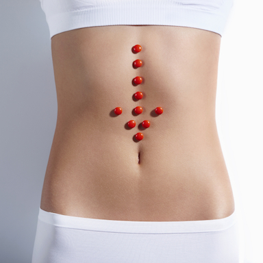 womans-stomach-with-tablets-on-it-how-your-gut-can-heal-your-brain-by-healthista.com