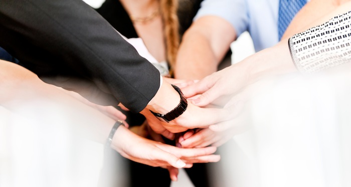 Hands joining in team work exercise, 7 ways to boost your brain performance, by healthista.com