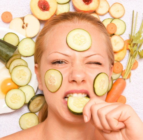 Woman with cucumber on her face, what to eat for great skin, by healthista