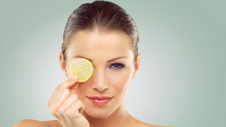 women with slice of lemon, what to eat for great skin, by healthista