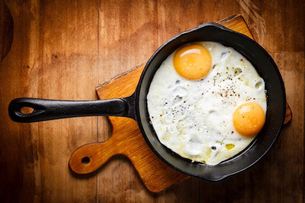 two fried eggs in pan, 11 reasons you're always hungry, by healthista