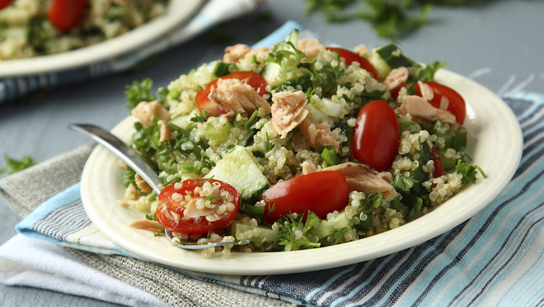 Salmon and quinoa salad, with cherry tomatoes, cucumber chunks and ...