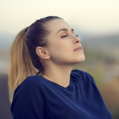 woman-breathing-in-mood-boosting-breathing-techniques-by-healthista