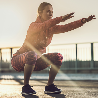 squatting-woman-in-sunshine-30-day-hiit-challenge-day-5-featured-by-healthista