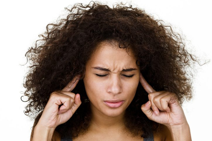 woman-plugging-ears-what-is-misophonia-by-healthista.com