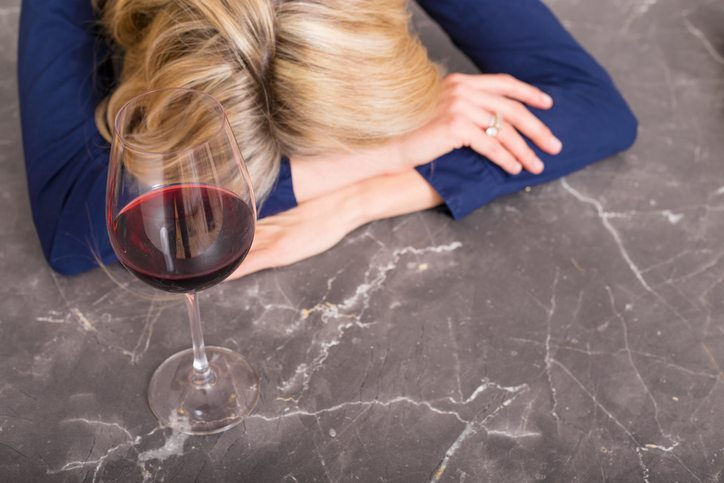 Depressed woman wine, 8 signs that you are having a breakdown, by healthista.com (feature)