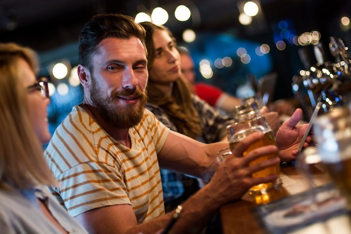 man with woman at bar Is my partner a serial cheater? Ask Sally Healthista