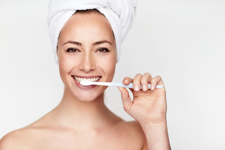 woman brushing teeth 6 things your dentist wishes you would do Healthista