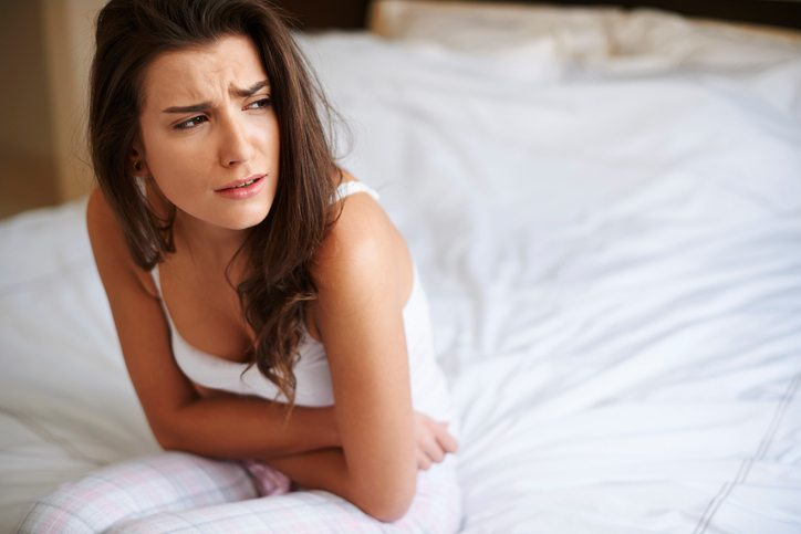 woman in pain Why sex hurts - the gynaecologist's guide Healthista