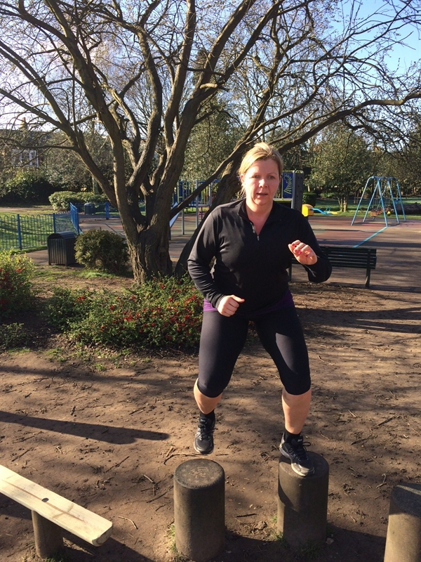 Caroline shedding the pounds doing step ups in the park.