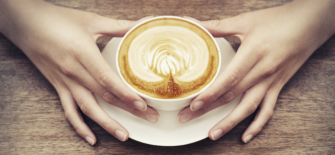 womans-hands-coffee-cup-10-best-coffee-shops-in-London-by-healthista.com