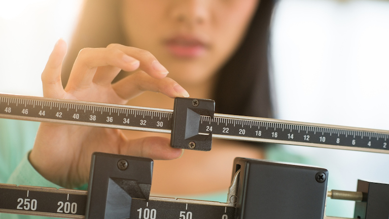 woman-checking-her-weight-weight-loss-by-healthista.com-main-image.jpg