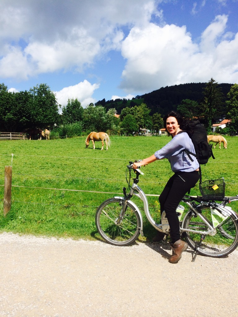bavaria woman biking by horses