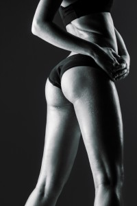 female athlete rear view, trained buttocks