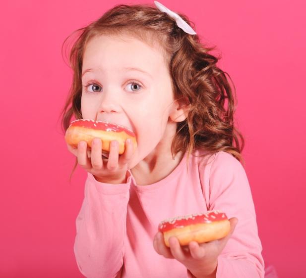 girl eating doghnuts