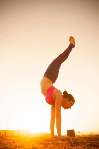 Yoga pose handstand, Should you do Yoga during your period by Healthista.com