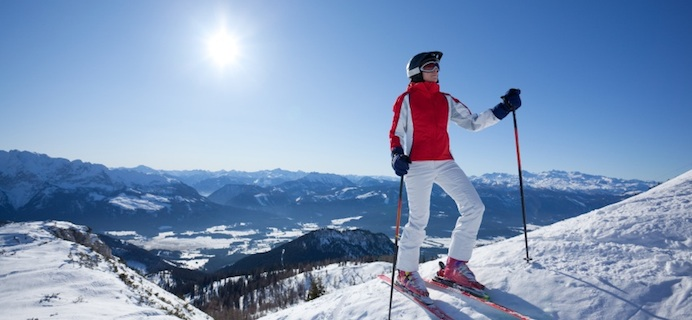 Woman skiing infront of snowy mountain, Snowga - the perfect preparation and recovery lesson for skiing season, by Healthista.com