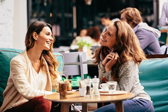 Two friends having coffee, How to beat low energy levels and avoid the afternoon slump, by Healthista.com