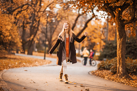 woman walking in the park, How to beat low energy levels and avoid the afternoon slump, by Healthista.com