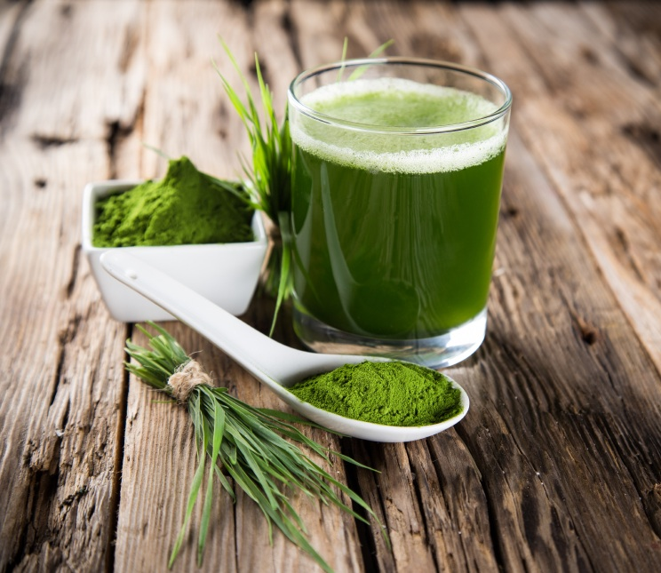 Wheatgrass juice on wooden table, The Alkaline Diet - what are the benefits?, by Healthista.com