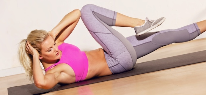 Woman doing side sit up, 30 Day Ab Challenge: Day 1, by Healthista.com