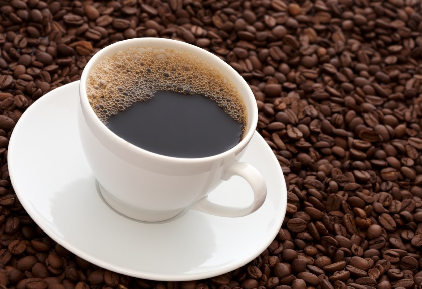 cup of coffee on a saucepan on top of coffee beans, The Alkaline Diet - what are the benefits?, by Healthista.com