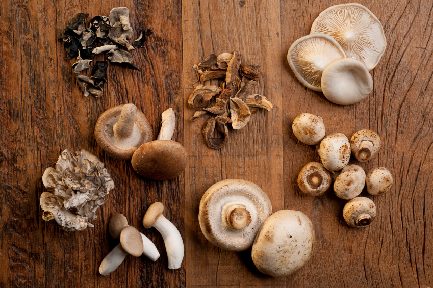 mushrooms on carving board, grocery list to help fight fatigue by healthista.com