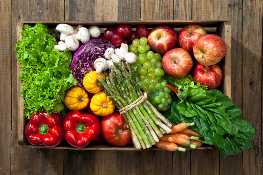 produce on wood table, grocery list to help fight fatigue by healthista.com