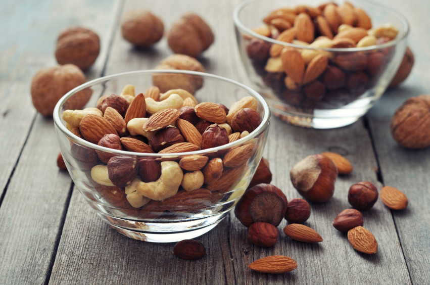 nuts in glass bowls, grocery list to help fight fatigue by healthista.com