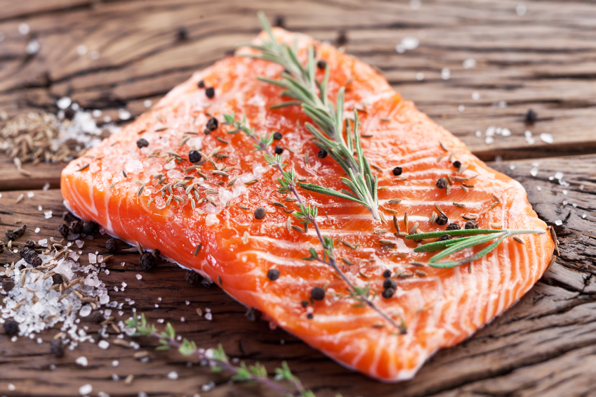 salmon on carving board, grocery list to help fight fatigue by healthista.com