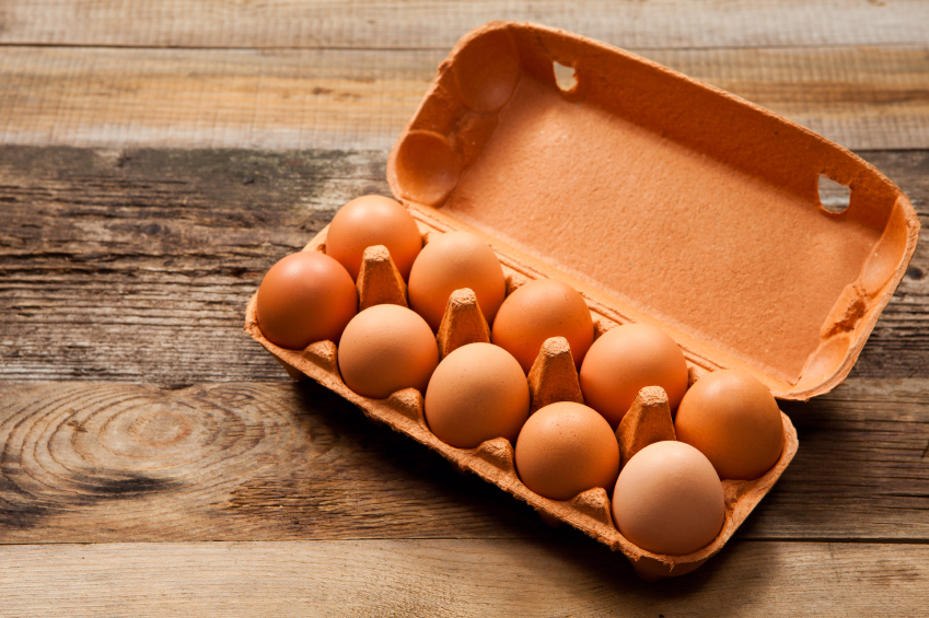 packaged eggs on table, grocery list to help fight fatigue by healthista.com