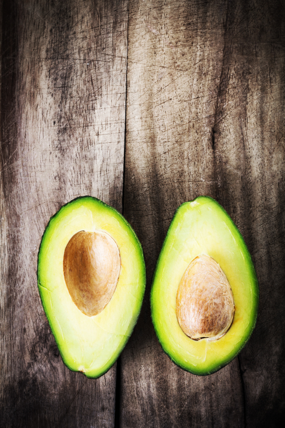two avocado halves, top ten foods for fertility by healthista.com