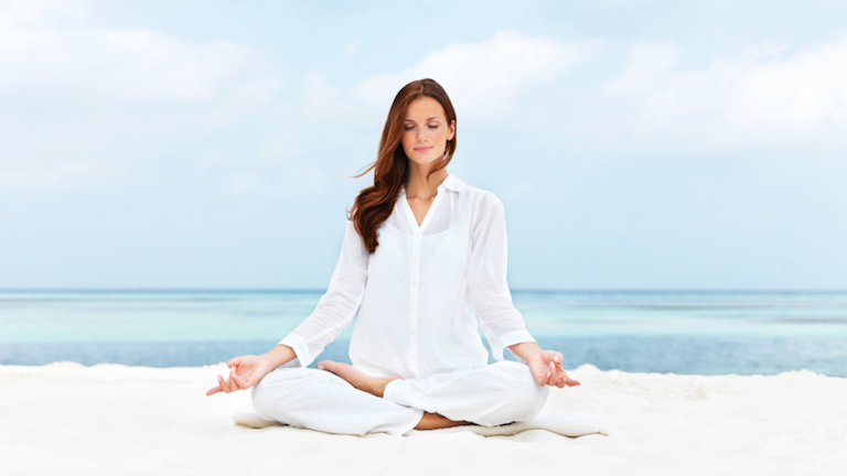 woman meditating, by Healthista.com