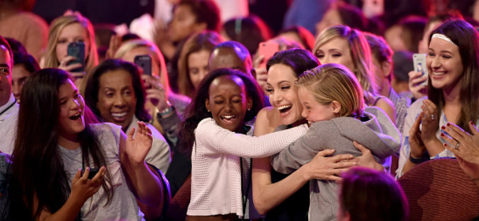 Angelina Jolie sharing embrace with kids after winning award, 6 signs that you're an outsider, by Healthista.com