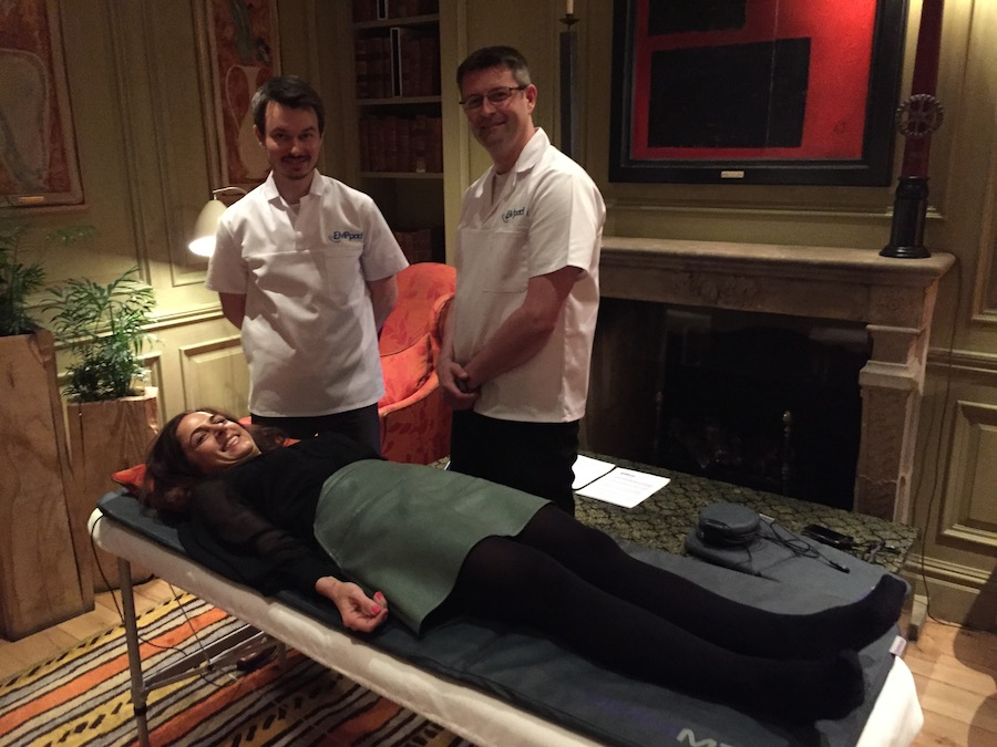 Anna lying on an EMP pad, electromagentic wave therapy, by healthista.com