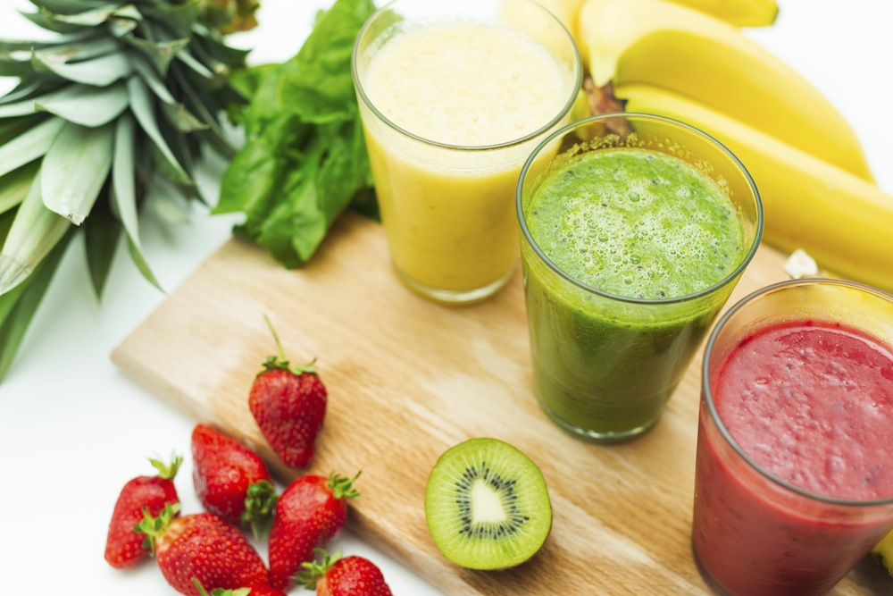 Fruit based juices on chopping board, Tips for a healthy juice cleanse & how to remain healthy afterwards, by Healthista.com