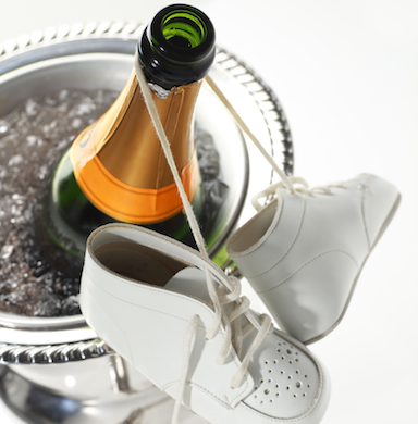 baby booties, champagn bottle, alcohol and fertility, by healthista.com