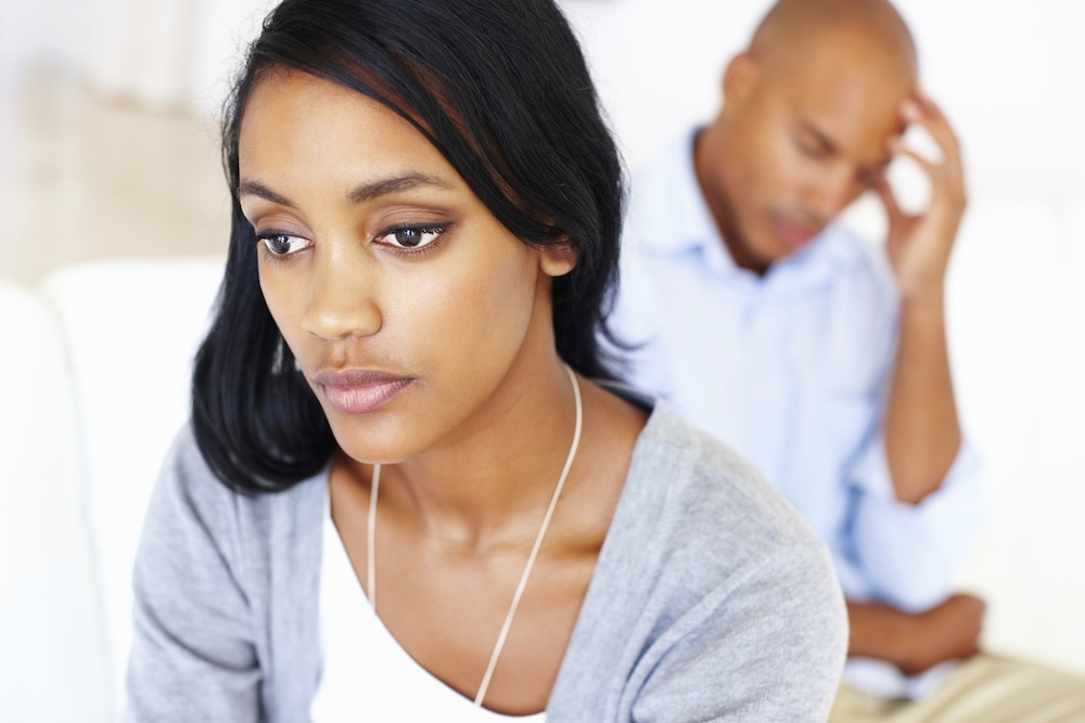 Couple looking stressed and unhappy, Why alcohol may be the best thing for your fertility, by Healthista.com